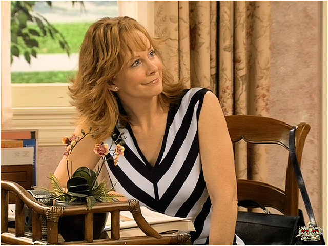 Reba with a warm smile on her face