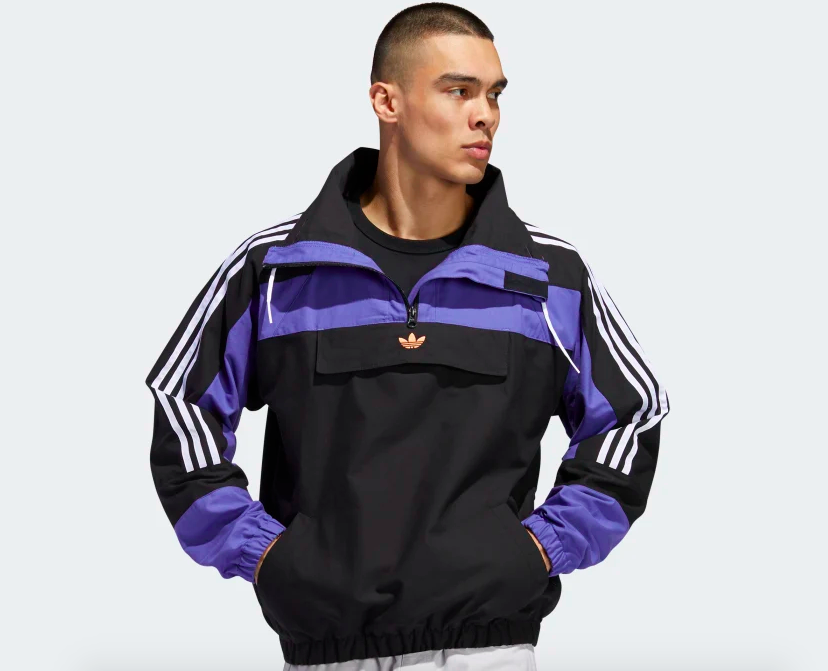Model wearing the jacket, which has a small gold Adidas trefoil in on the chest flap