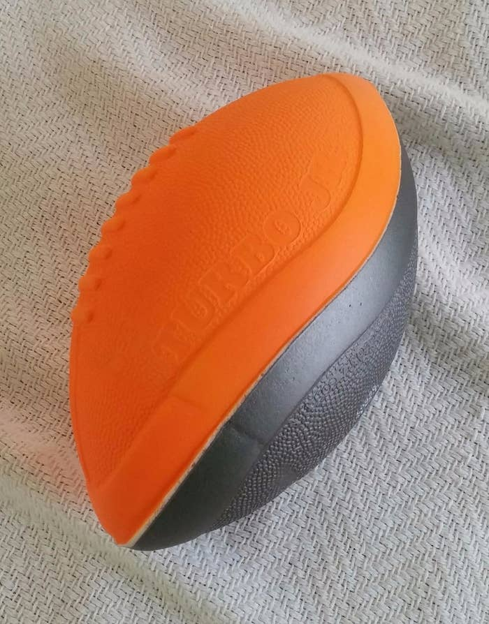 A bright orange and black Nerf football
