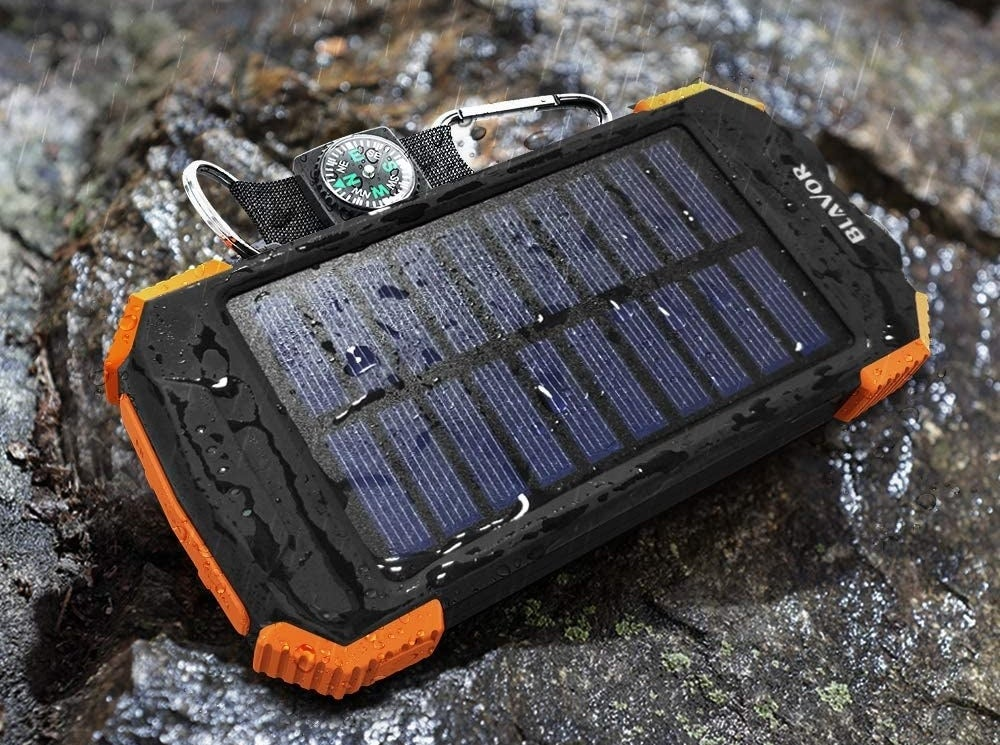 The solar power bank that's wet to show how it's waterproof