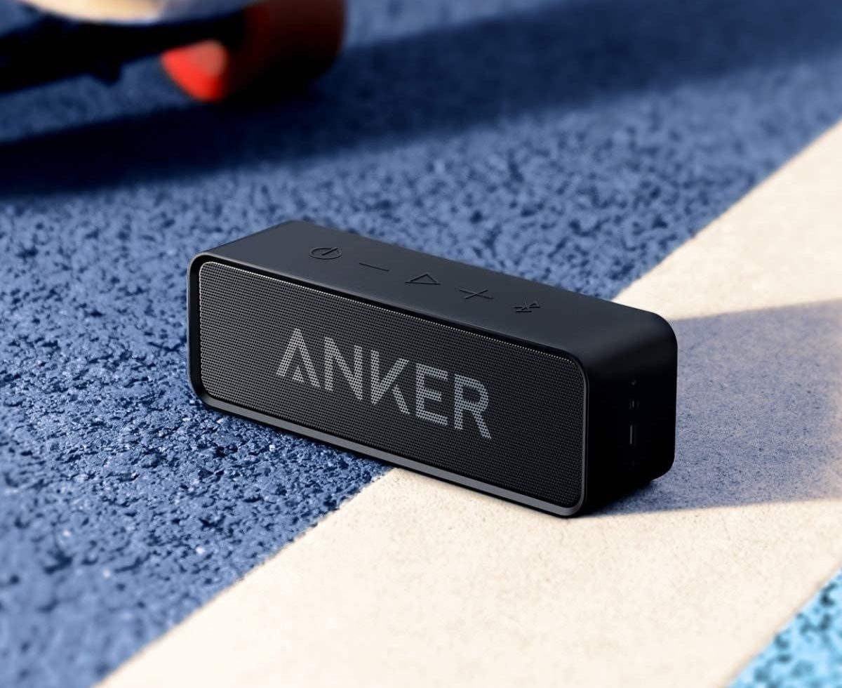 "The rectangular speaker in black with the brand name ""Anker"" written across"