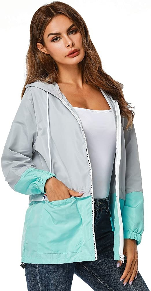 model wearing the blue and gray jacket