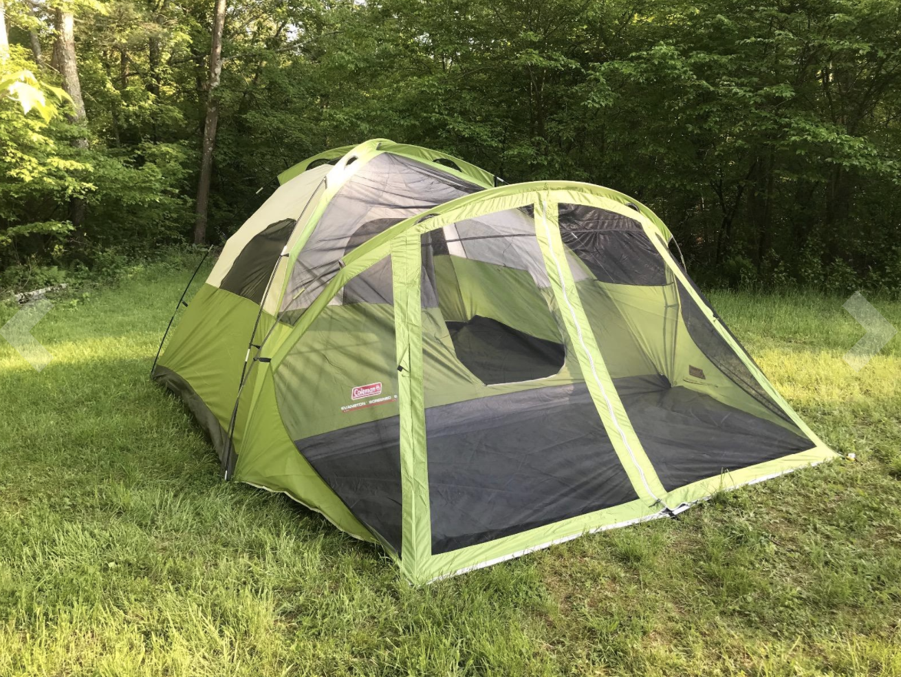 Reviewer photo of tent outside on the grass, showcasing the screened in porch portion