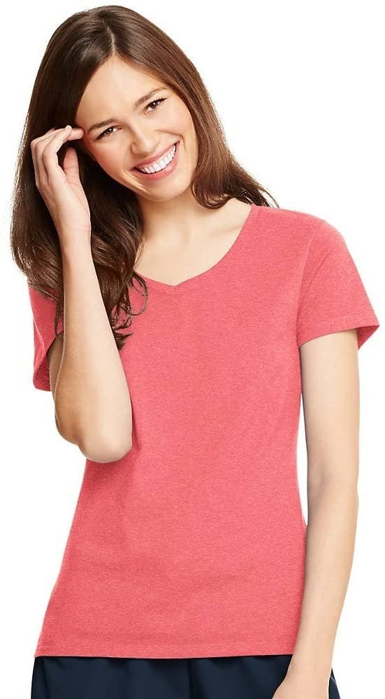 model wearing coral V-neck shirt