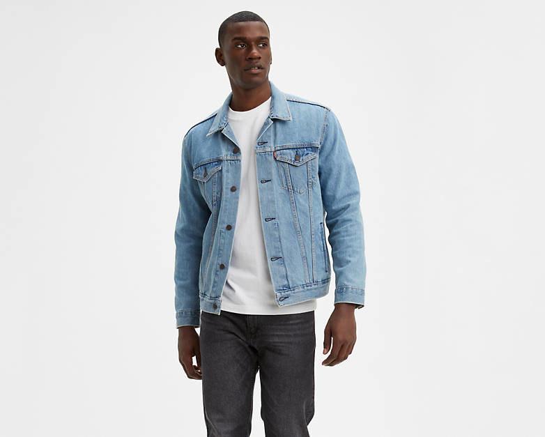 Model wearing Levi's light wash trucker jacket