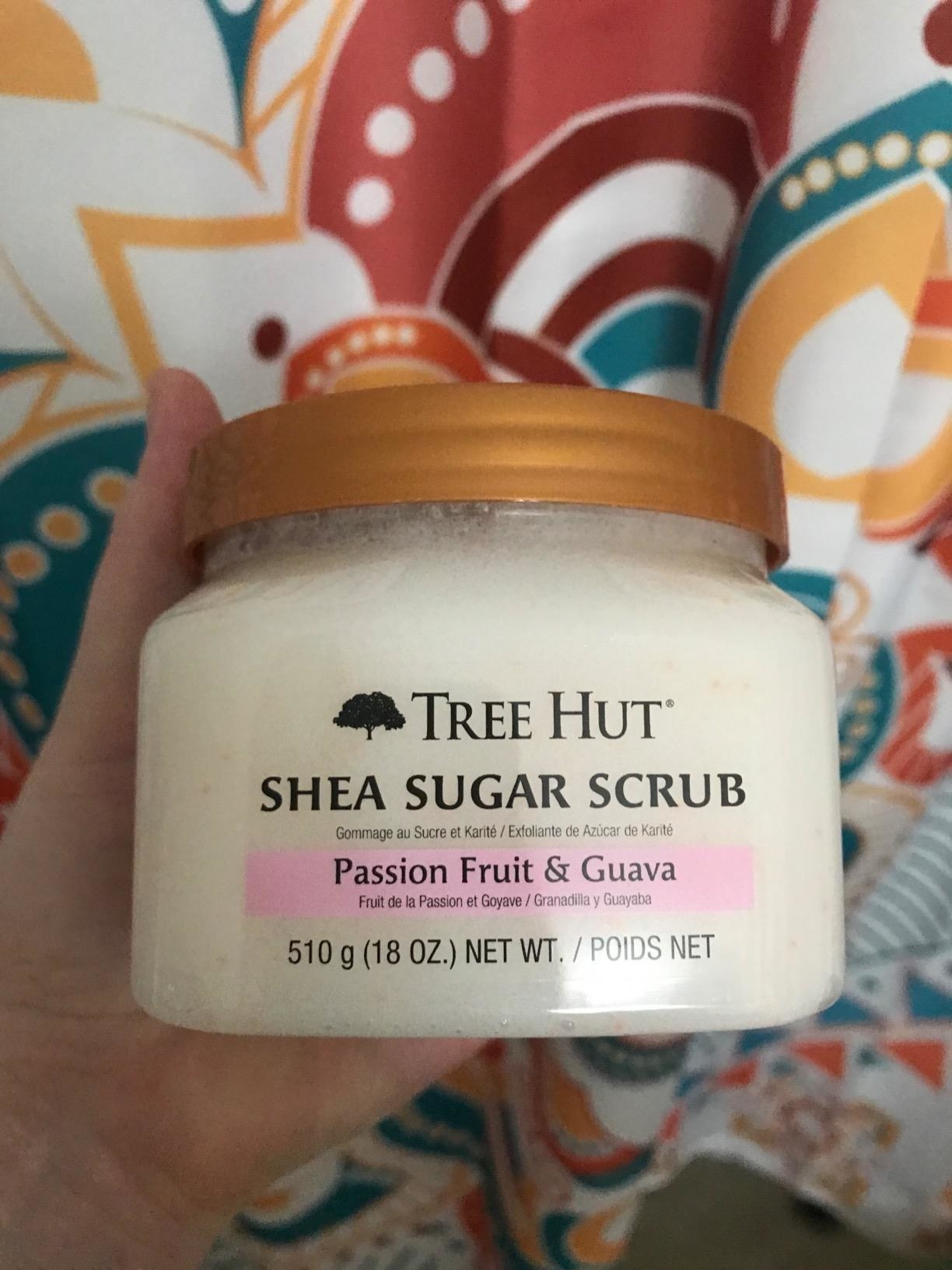 A close-up of the jar of sugar scrub
