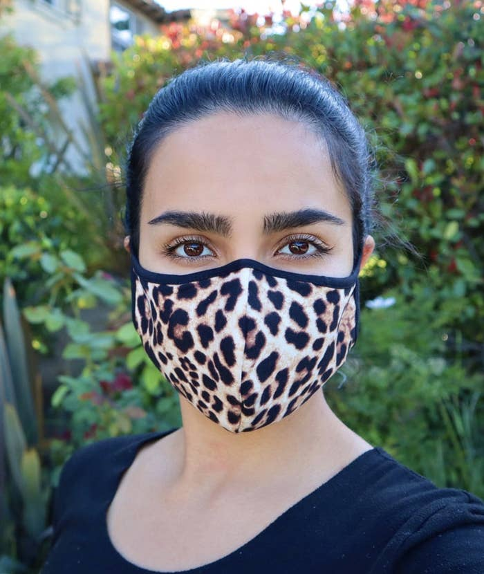 Model wears a leopard print face mask with a black shirt