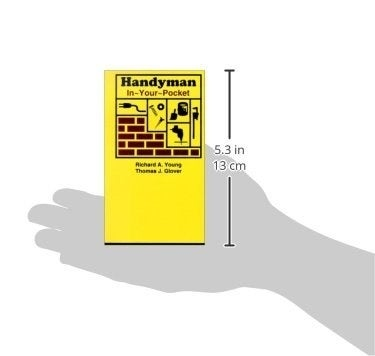 a grey illustration of a hand holds the book with the measurements that the book is 5.3 inches tall