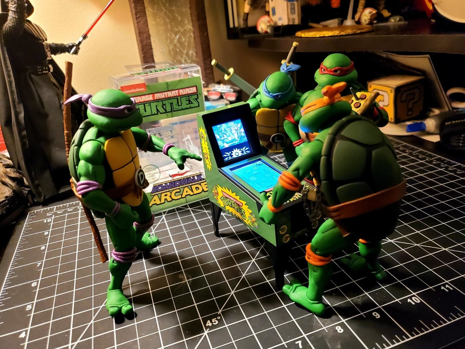 a reviewer image of ninja turtle figures playing with the mini pinball machine