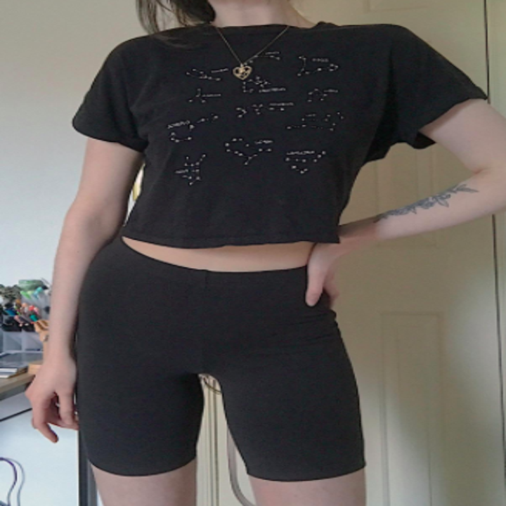 reviewer pic of black bike shorts styled with boxy black tee