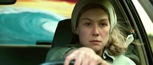 Amy driving a car in Gone Girl.
