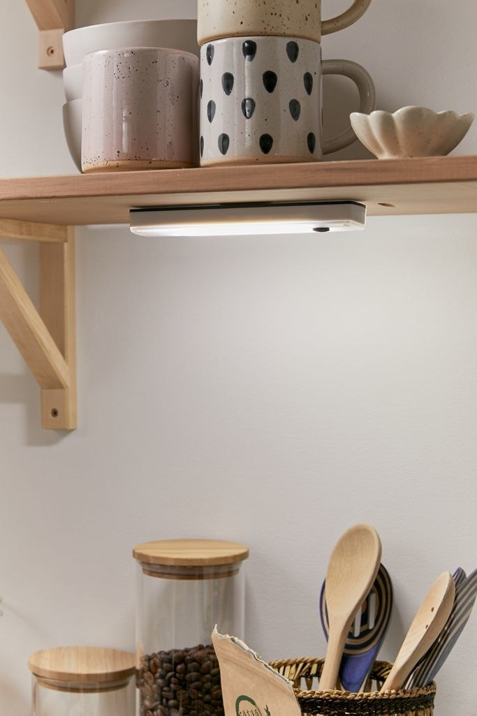 Thin rectangle light under a cabinet in a kitchen