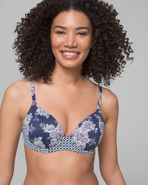 Model wearing the bra in navy blue and white floral pattern
