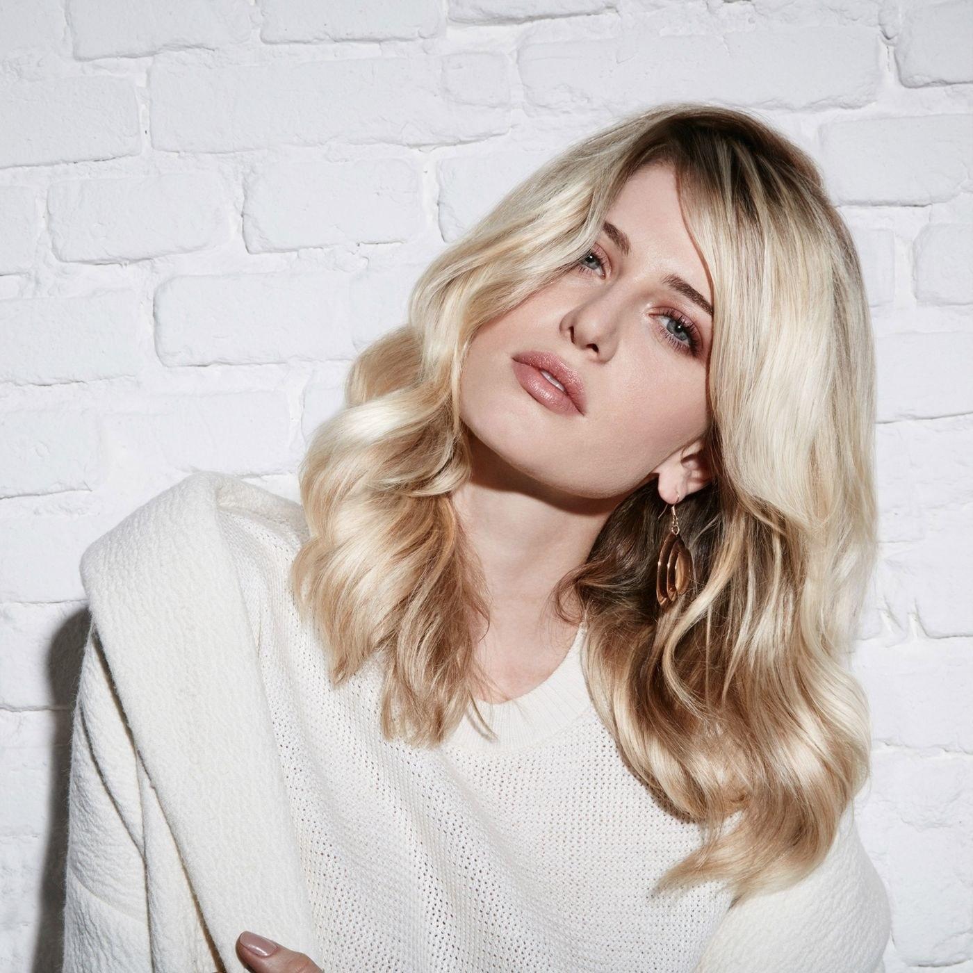 Model with bright, voluminous, shiny hair
