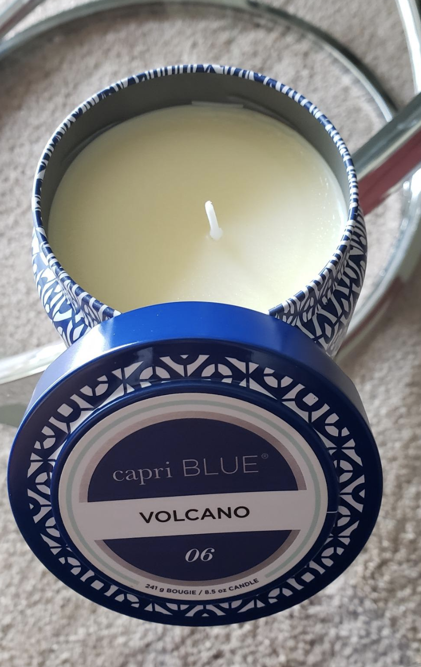 the candle in a tin can with the twist-off lid sitting beside it