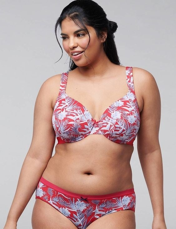Model wearing the bra in red and white tropical pattern