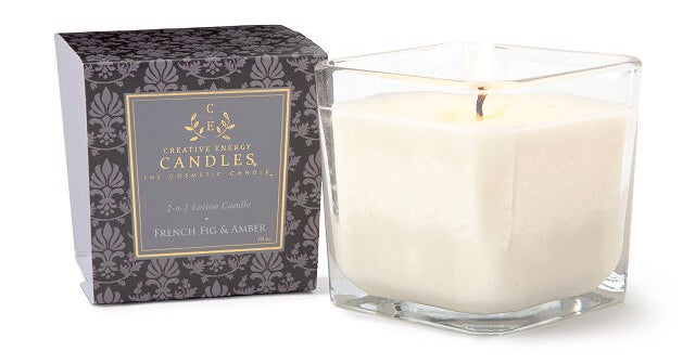 a candle in a square jar