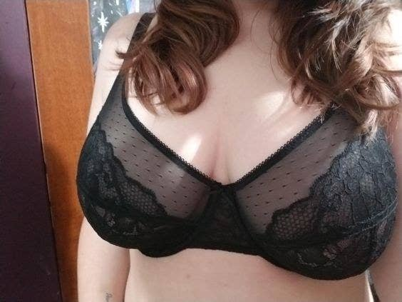 Reviewer wearing the mesh and lace bra in black