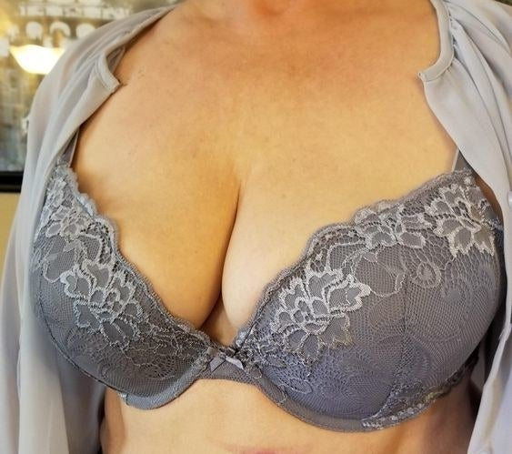 Reviewer wearing the bra in grey