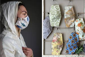 On the left, a model wears a feather-printed face mask. On the right, an assortment of map-printed and floral-printed face masks on a frame