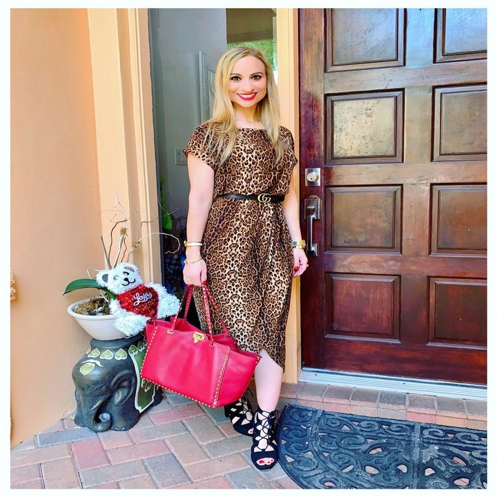 Another reviewer wearing the dress in leopard print