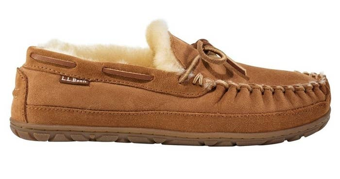 A side view of a tan leather shearling-lined moccasin