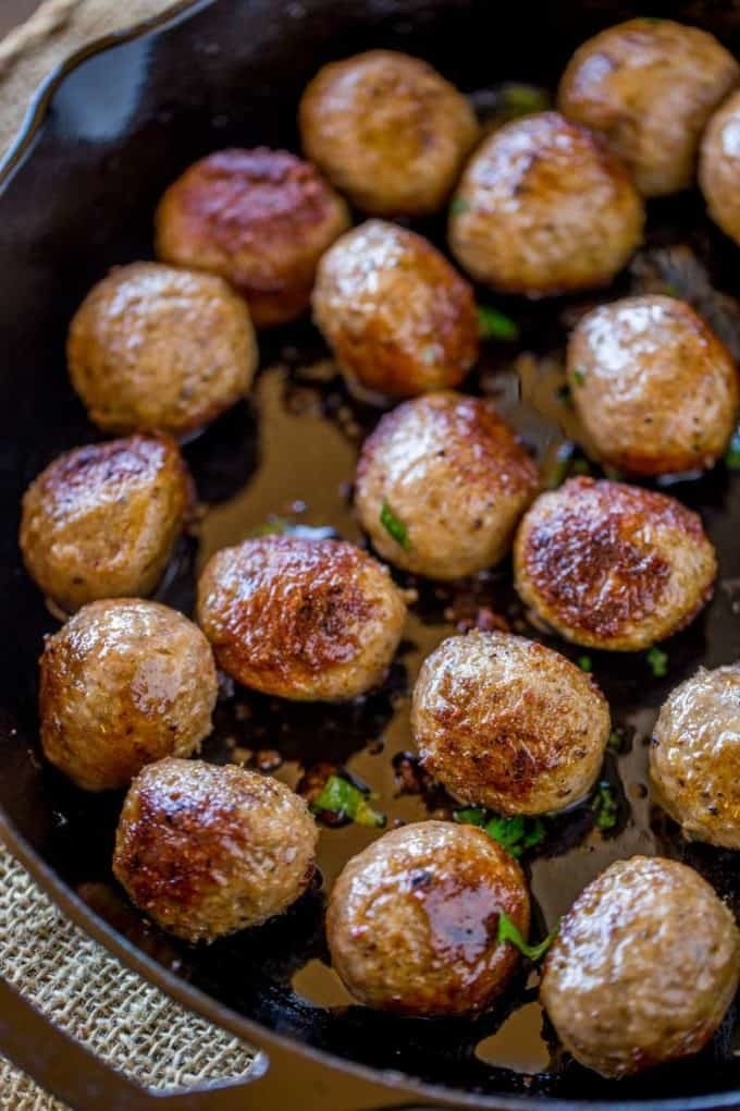 A skillet full of freshly cooked meatballs.