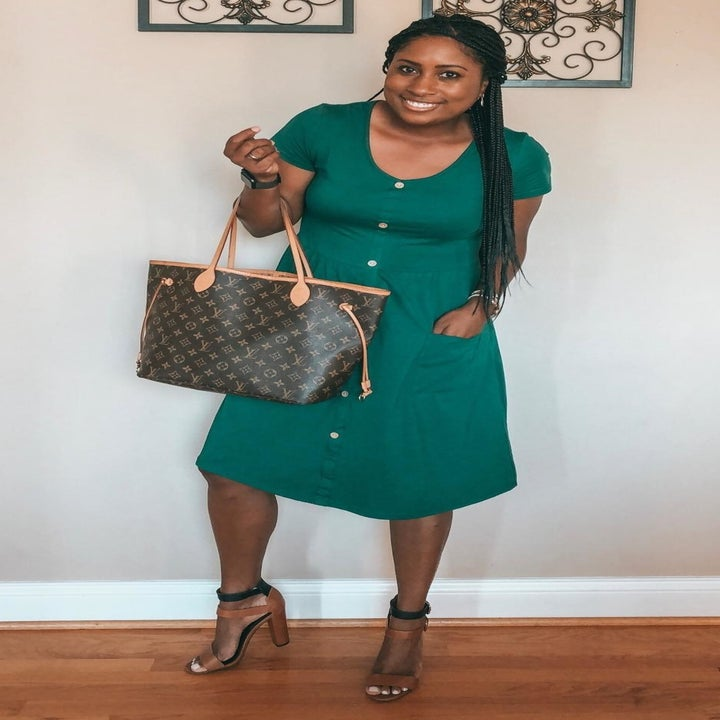 Reviewer wearing the dress in green with heels