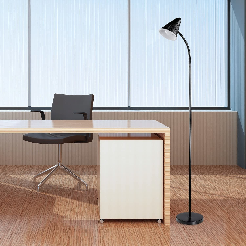 Black plastic floor lamp in an office