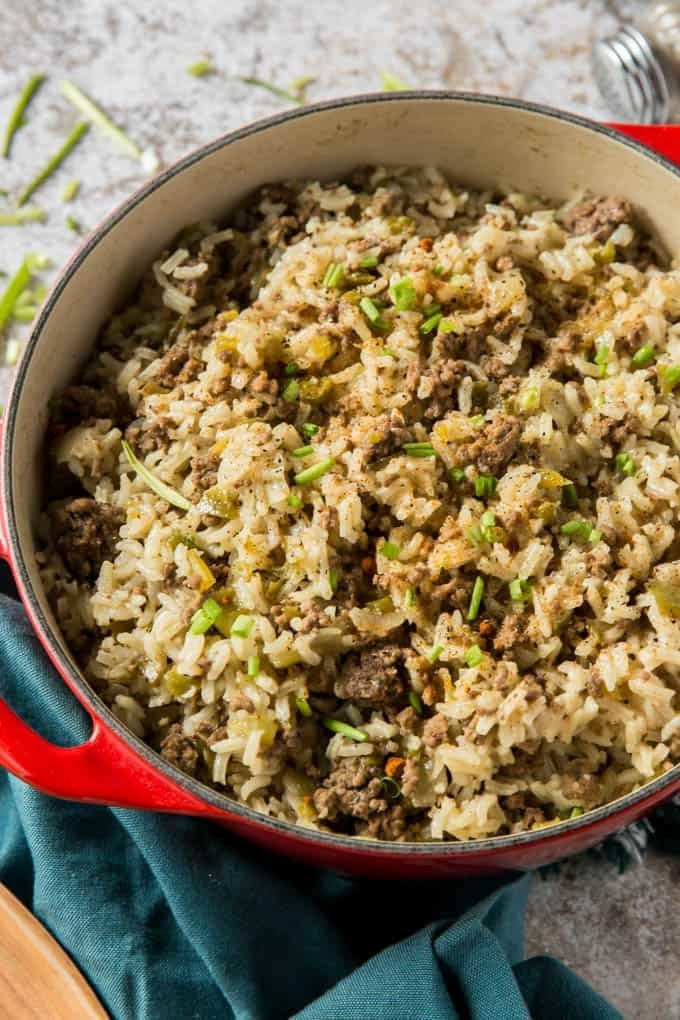 A big pot of rice with ground beef and vegetables.