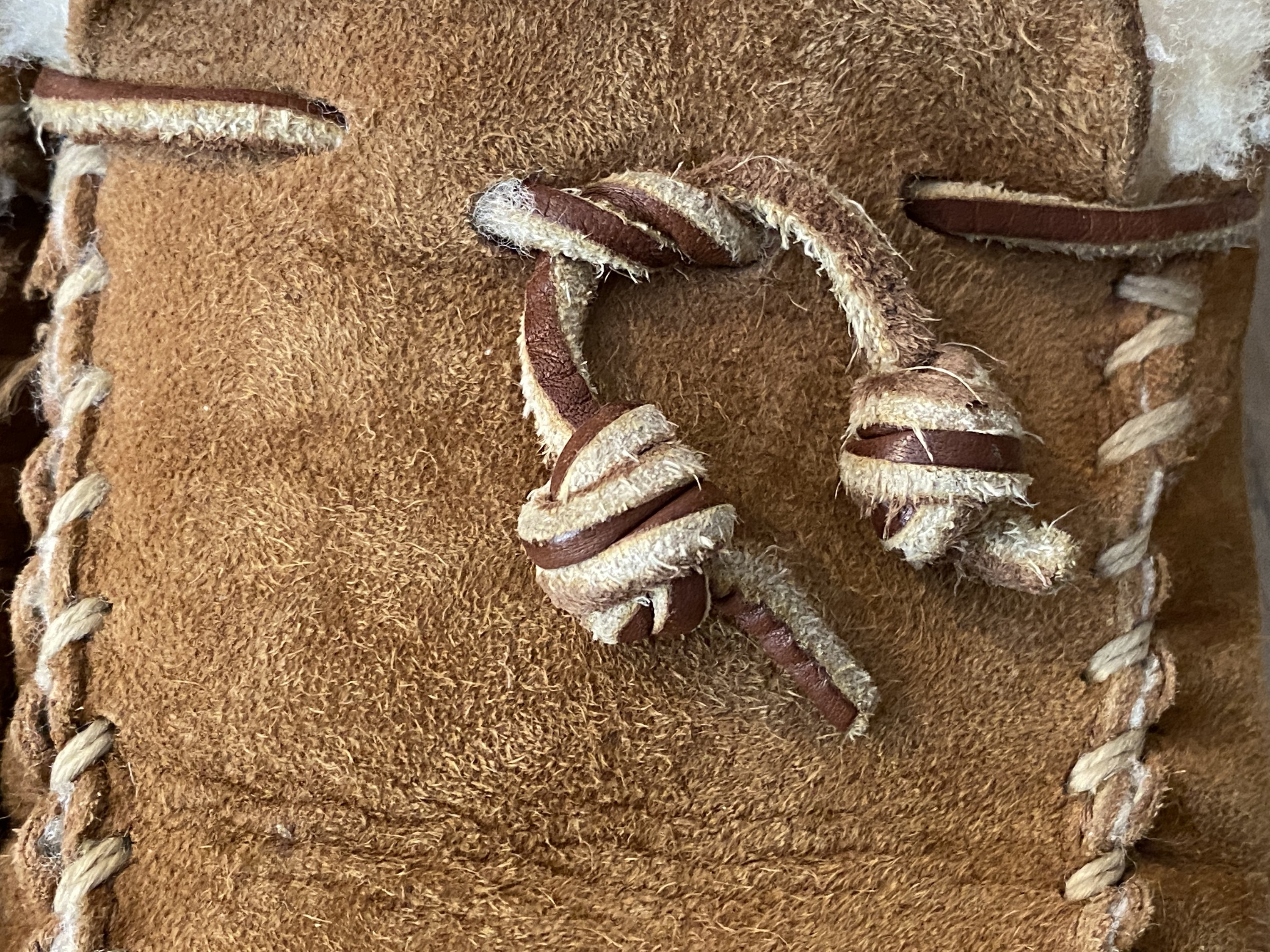 A close-up of the BuzzFeed editor's barrel knot on a moccasin