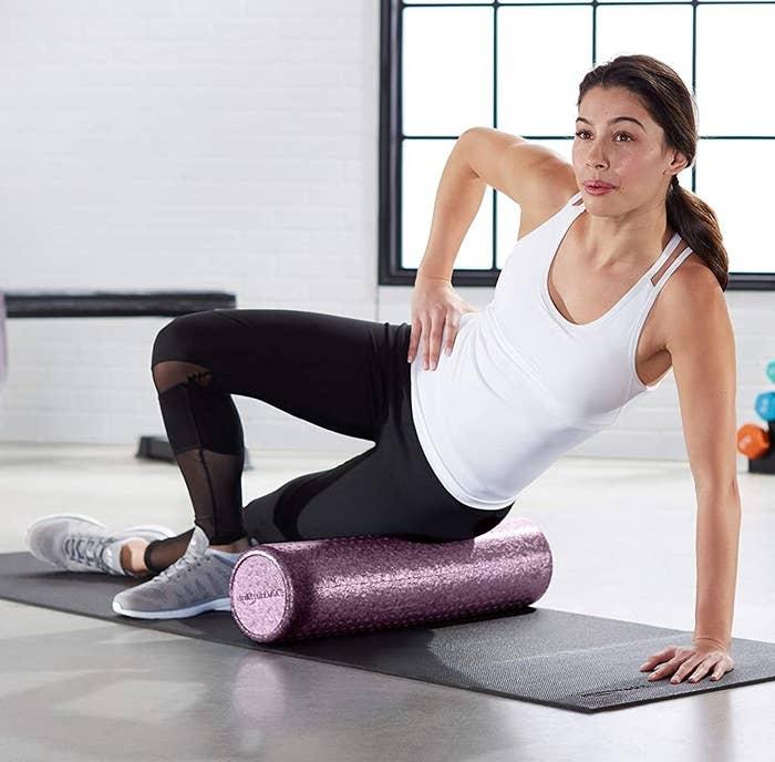 model using glitter pink foam roller