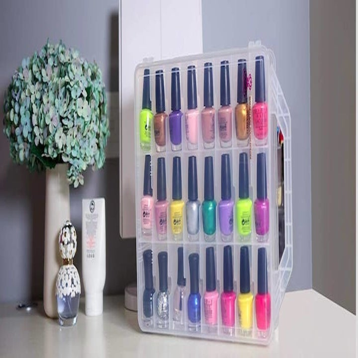 The same nail polish bottles now clean and orderly inside of the organizer