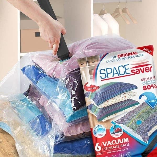 A person using a vacuum to seal the vacuum bag