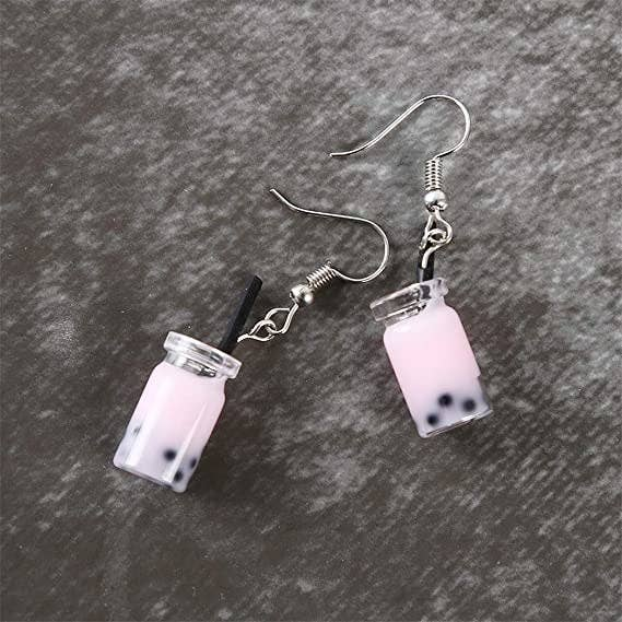 Small earrings that look like a light pink bubble tea with visible bobas