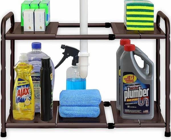 The adjustable rack holding various cleaning products