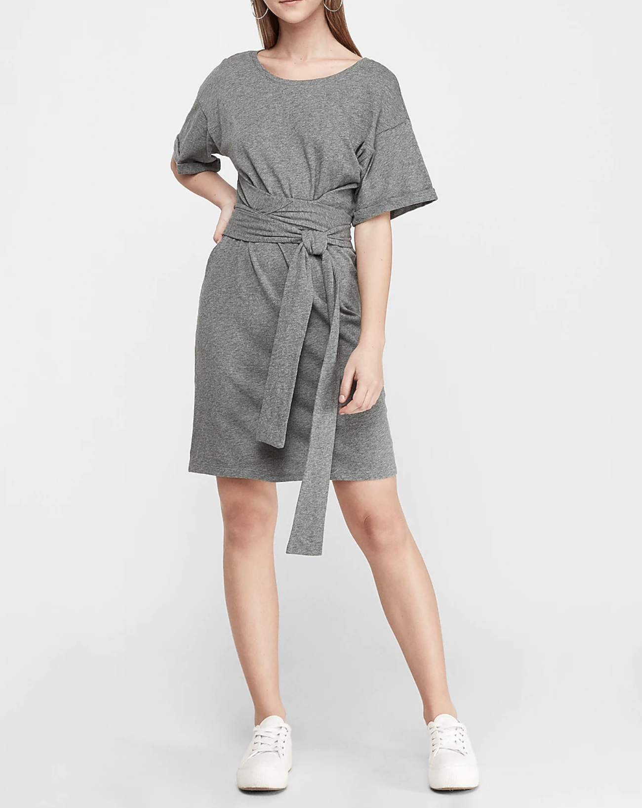 A dress with wide short sleeves that stop above the elbow and a long waist belt wrapped into a hanging sash at the waist. It has a curved neckline.