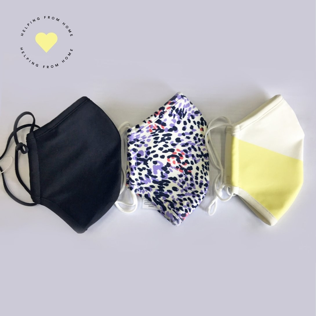 three masks folded in half in three patterns: black, purple spotted, and yellow colorblock