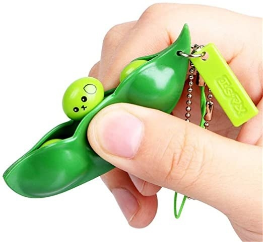 hand squeezing keychain so one of the little peas comes out
