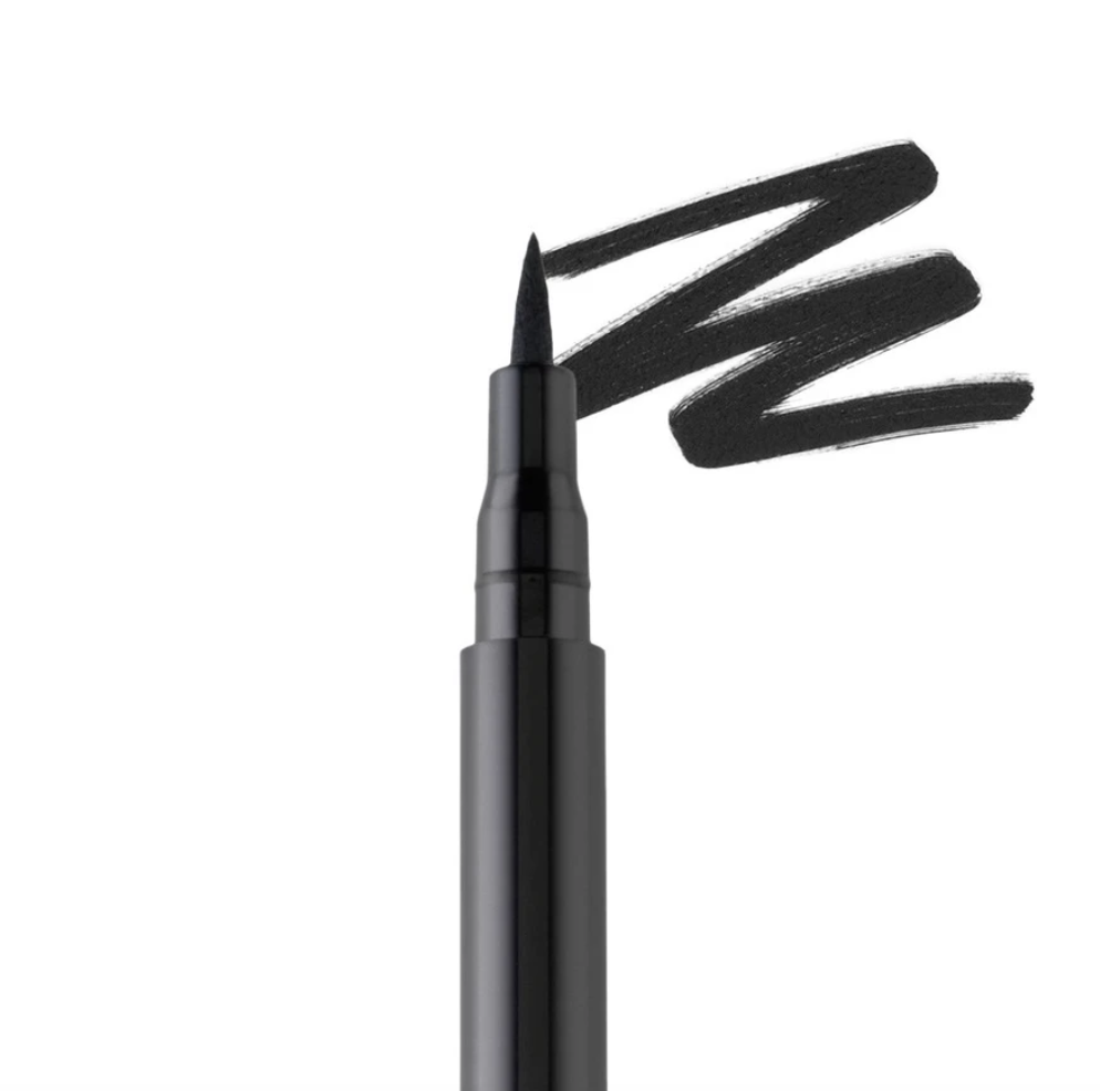A closeup of the eyeliner tip next to a streak of eyeliner on a surface