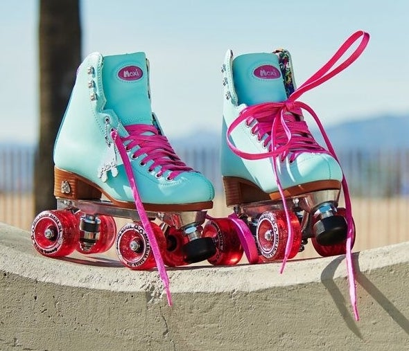 blue skates with hot pink wheels and laces
