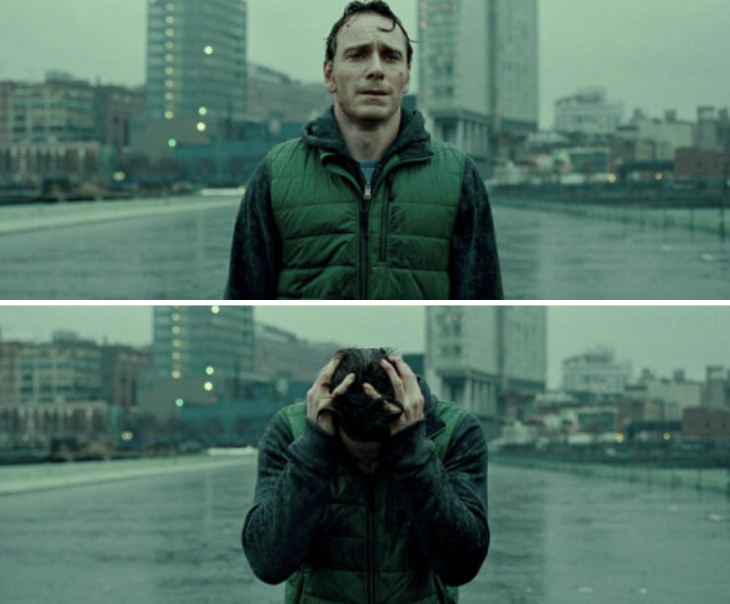Fassbender's character running in the rain and crying