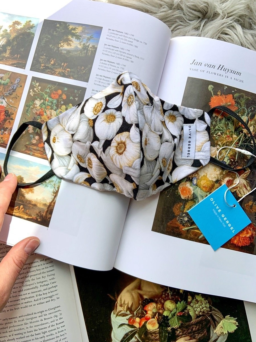 A mask with a garlic pattern laid on an art book