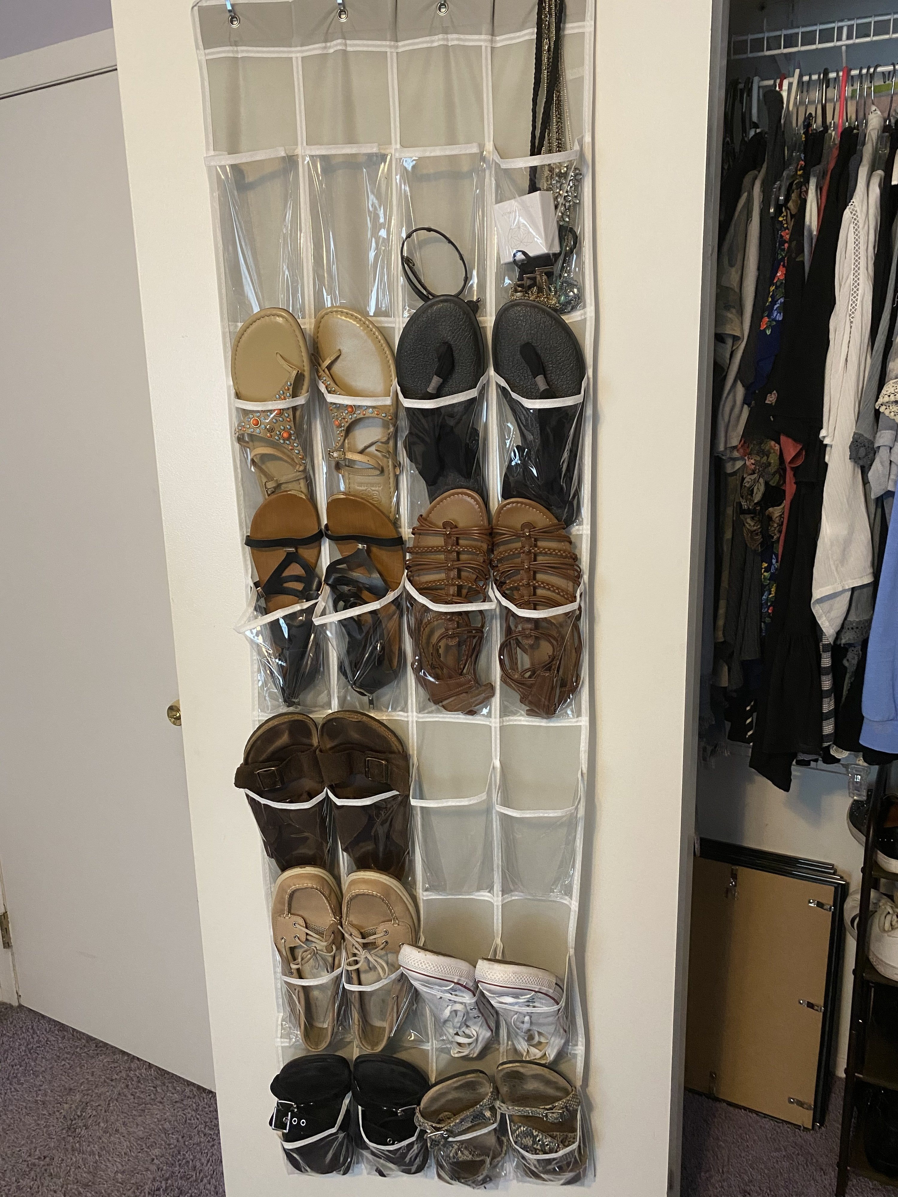 The organizer holding various shoes