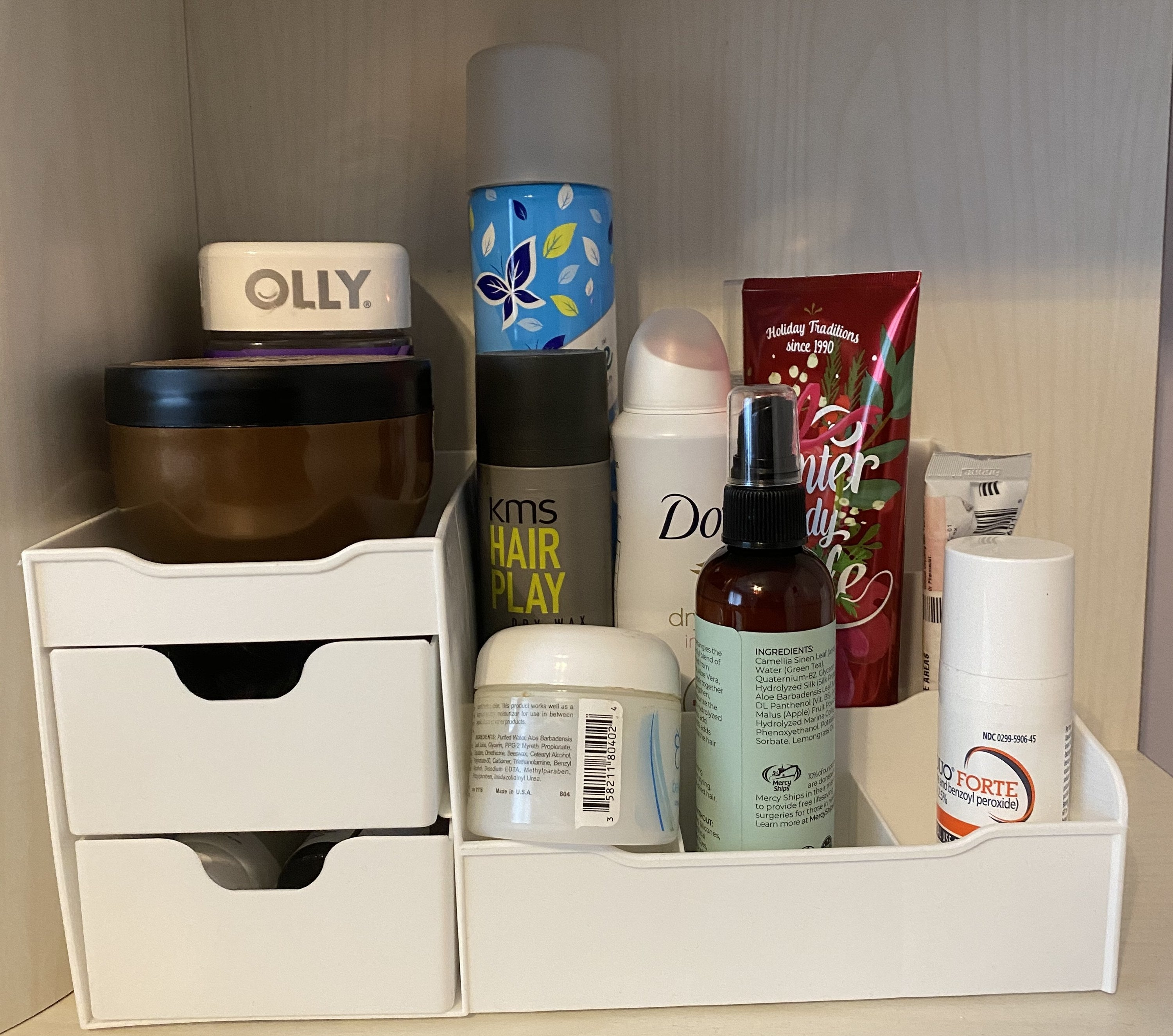 The vanity organizer with skincare and hair products on it