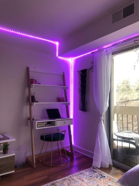 Reviewer using the light string in purple to line a corner of the room