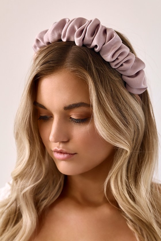 Model wearing headband with ruching similar to a scrunchie in pink