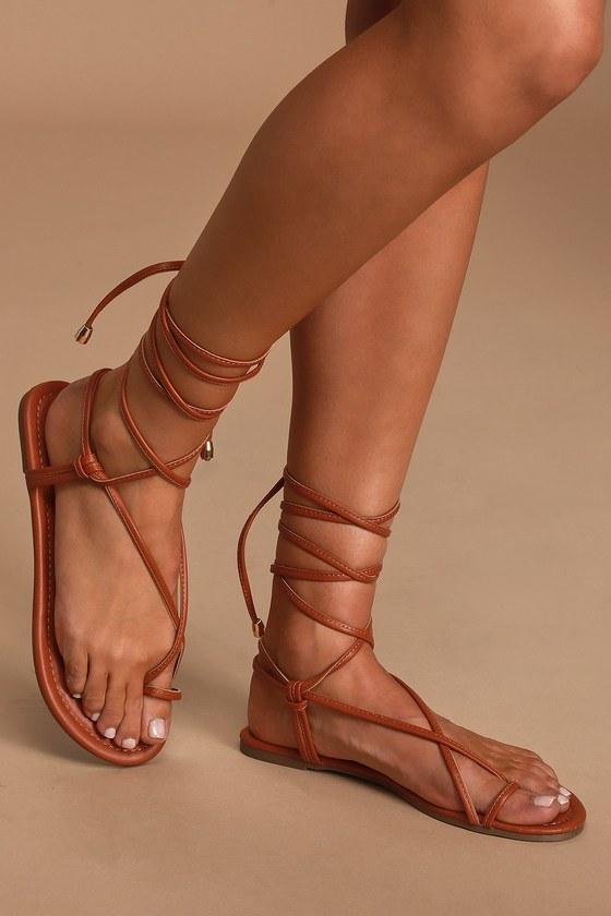 Model wearing shoes in tan