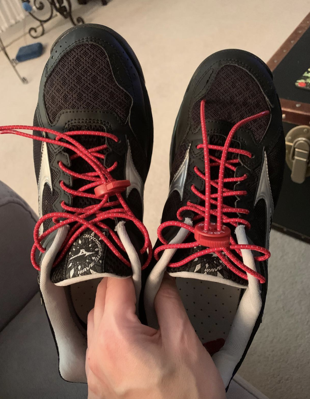 grey sneakers with the no-tie shoelaces in pink