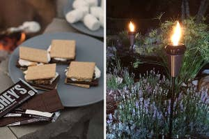 to the right is an open hershey's chocolate bar next to a grey plate filled with four s'mores, to the right is two modern, metal tiki torches with bright flames placed in a bed of flowers